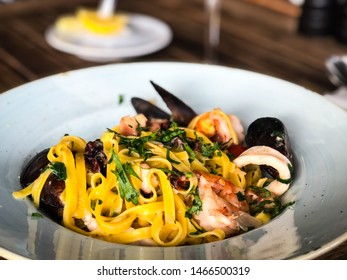 fresh italian pasta with seafood - spaghetti, tagliatelle and fresh fusilli
