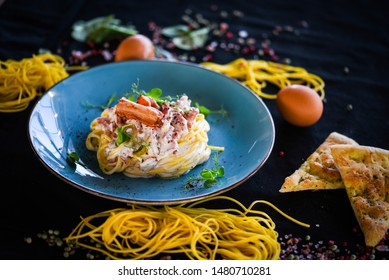 fresh italian spaghetti carbonara with tasty ingredients - cream, egg, bacon
