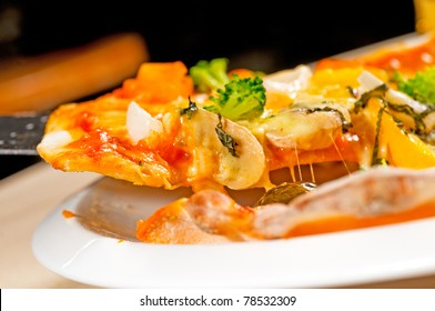 fresh italian thin style  vegetarian pizza with fresh mixed vegetables close up