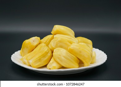 Fresh jackfruit slices on a white plate. sweet yellow jackfruit ripe. vegetarian, vegan, raw food. Exotic tropical fruit - isolated