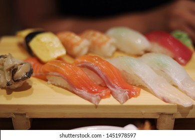 Fresh Japanese-style assorted sushi chopping board
