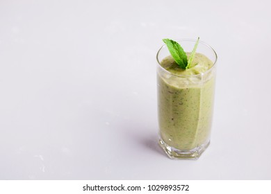Fresh juice from fruits and vegetables in a glass on the table, a natural cool drink - cleansing the body