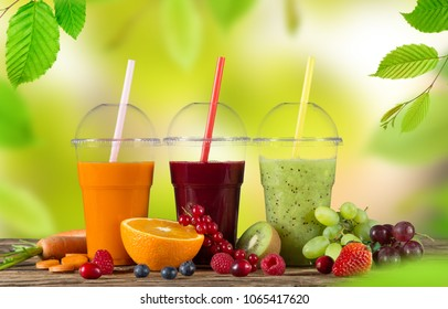 Fresh juice mix fruit, healthy drinks on wooden table, close-up.