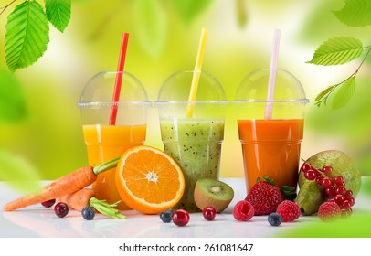 Fresh juice mix vegetables and fruit, healthy drinks on white table.