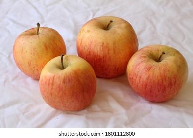 Fresh juicy apples on a white napkin