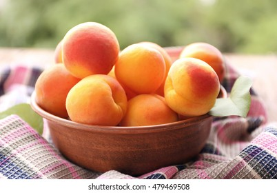 Fresh juicy apricots in bowl