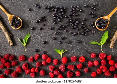 Fresh juicy berries on dark concrete background. Raspberry, blueberry.  Summer harvest. Healthy eating concept. Top view