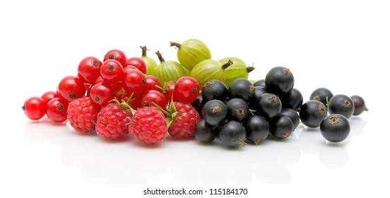 Fresh juicy berries. Red and black currants and gooseberries on a white background.