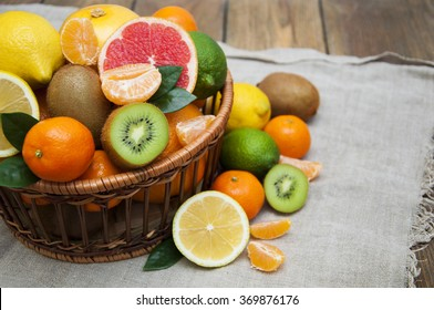 Fresh juicy citrus fruits in basket on a sacking background