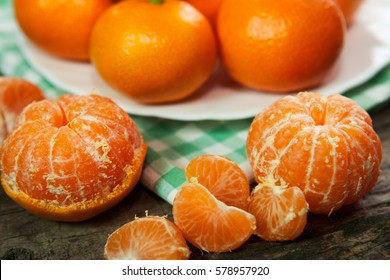 Fresh juicy clementines or tangerines on table