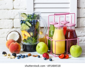Fresh juicy ingredients in blender for making smoothie.