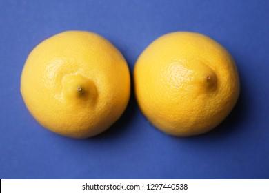 Fresh juicy lemons on color background. Erotic concept