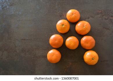 Fresh juicy mandarins, winter time fruits. Mandarins forming A letter.