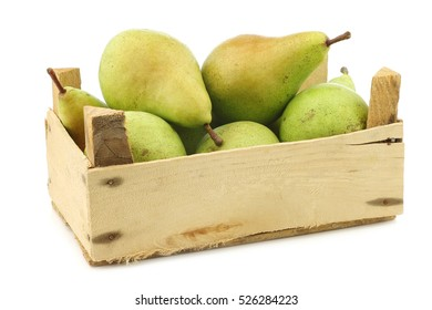 fresh juicy migo pears in a wooden box on a white background