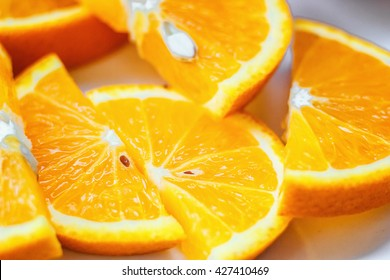 Fresh juicy orange fruit slice isolated. Citrus fruit-natural vitamin C. Studio photography.