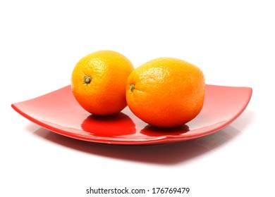Fresh juicy oranges isolated on white