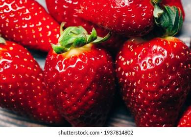 Fresh, juicy, ripe red strawberry berries close-up