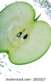 fresh juicy slice of apple, in water