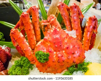 Fresh, juicy and tasty poached whole Alaskan king crab or Taraba crab in their shell on ice bed. Sweet and flavorful. Contain cholesterol, but low in saturated fat and also have omega-3 fatty acid.