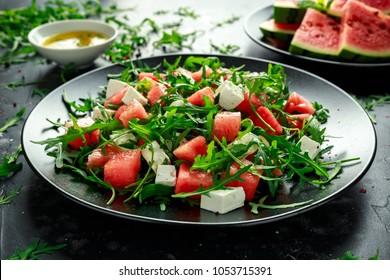 Fresh Juicy Watermelon arugula Feta salad with mint and orange, lemon dressing. summer dish. healthy food