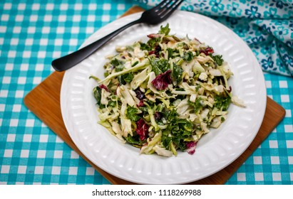 Fresh kale Coleslaw Salad on a White Bowl