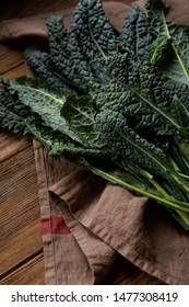 Fresh kale leaves on wooden boards
