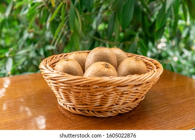 Fresh Kiwi fruit from the fruit basket - Shutterstock ID 1605022876