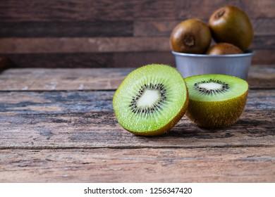 Fresh kiwi fruit in bowl on table