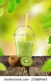 Fresh kiwi fruit, healthy drink on wooden table.