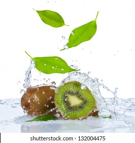 Fresh kiwi and leaf falling in water