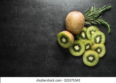 Fresh kiwi on black background. Copy-Space