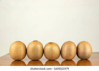 Fresh Kiwi on the table - Shutterstock ID 1605021979