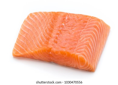 Fresh lachs fillet with basil on the white background.