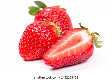 Fresh large strawberries on a light background.