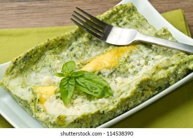 fresh lasagna with pesto sauce