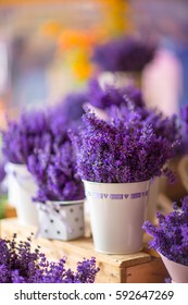 Fresh lavender in the English farm shop is in vintage white metal pails