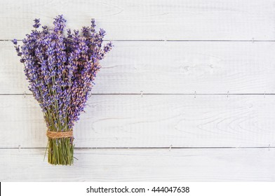 fresh lavender flowers on white wood table background. Top view of a fresh lavender flowers, a bouquet of lavender on a wooden background, Copy space for your text.