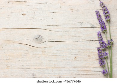 Fresh lavender flowers on wooden background. Lateral frame with space for text