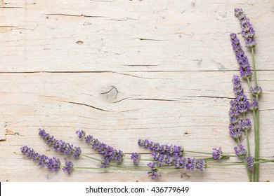Fresh lavender flowers on wooden background. Frame with space for text. Lovely postcard