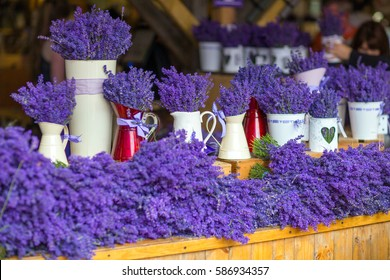 Fresh lavender at the market is in vintage white metal jugs