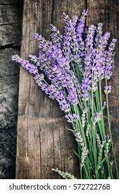 Fresh lavender over wooden background. Summer floral background with lavender flowers and wood.