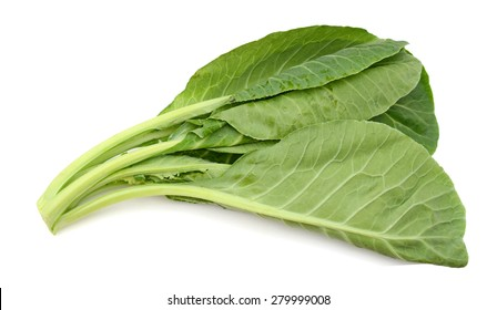 fresh leaves of collards isolated on white