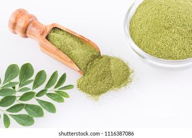 Fresh leaves and moringa powder - Moringa oleifera. Top view
