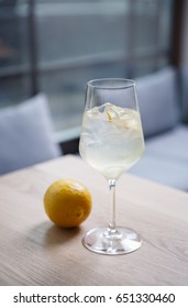 Fresh lemon cocktail drink in the bar.Crystal clear glass with refreshing lemonade served with ice.Sour screwdriver alcoholic cocktail for hot summer day.Vodka with natural juice