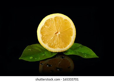 fresh lemon with drops of water on black background