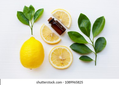 Fresh lemon with lemon essential oil on a white background.