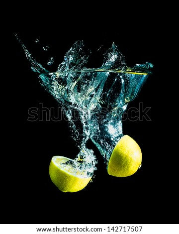 fresh lemon falling into water