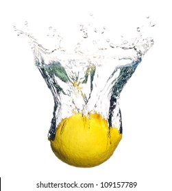 Fresh lemon fruit splashing in the water isolated on white background with bubbles