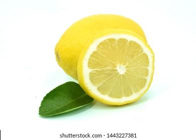 Fresh lemon fruits with leaves isolated on white background
