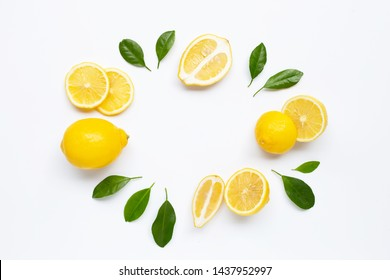 Fresh lemon with green leaves on white background. Copy space